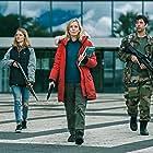 Léa Drucker, Emilie de Preissac, and Paul Gorostidi in War of the Worlds (2019)