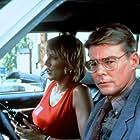 Sandahl Bergman and Jan-Michael Vincent in Raw Nerve (1991)
