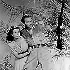 Joan Bennett and Douglas Fairbanks Jr. in Green Hell (1940)