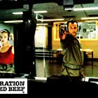 Jean Reno and Isabelle Renauld in L'opération Corned Beef (1991)