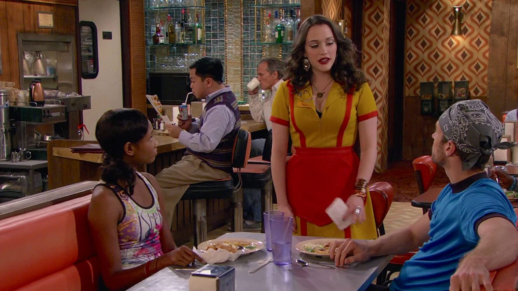 Kat Dennings, John Ruby, and Ajarae Coleman in 2 Broke Girls (2011)