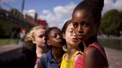 """Amy, an 11-year-old girl, joins a group of dancers named """"the cuties"""" at school, and rapidly grows aware of her burgeoning femininity, upsetting her mother and her values in the process."""