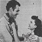 Sunset Carson and Peggy Stewart in Code of the Prairie (1944)