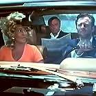 Richard Burton, Elizabeth Taylor, and Beau Bridges in Hammersmith Is Out (1972)