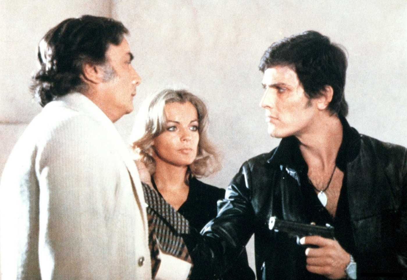 Romy Schneider, Paolo Giusti, and François Perrot in Les innocents aux mains sales (1975)