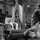 Angie Dickinson, Gene Barry, and Warren Hsieh in China Gate (1957)
