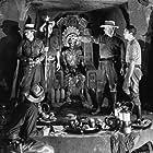 Douglas Fairbanks Jr., Alan Hale, George Bancroft, and John Howard in Green Hell (1940)