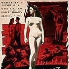 Robert Hossein, Serge Reggiani, Henri Vidal, and Marina Vlady in Les salauds vont en enfer (1955)