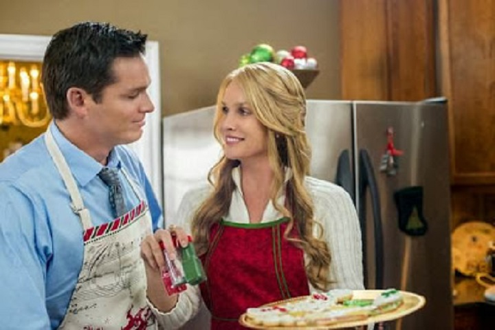 Nicollette Sheridan and Bart Johnson in The Christmas Spirit (2013)