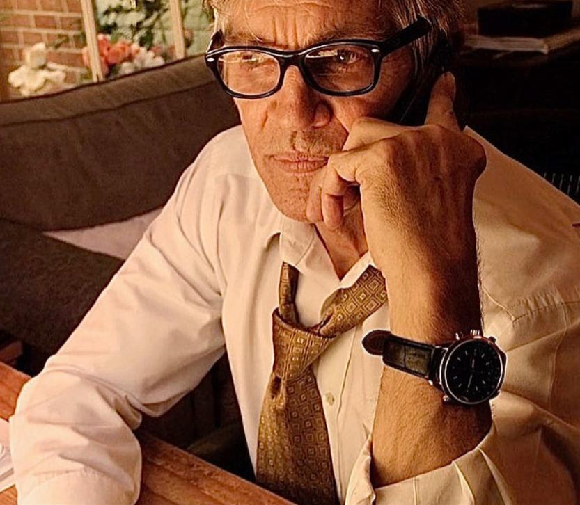 Eric Roberts as Ross Langely deep in thought.