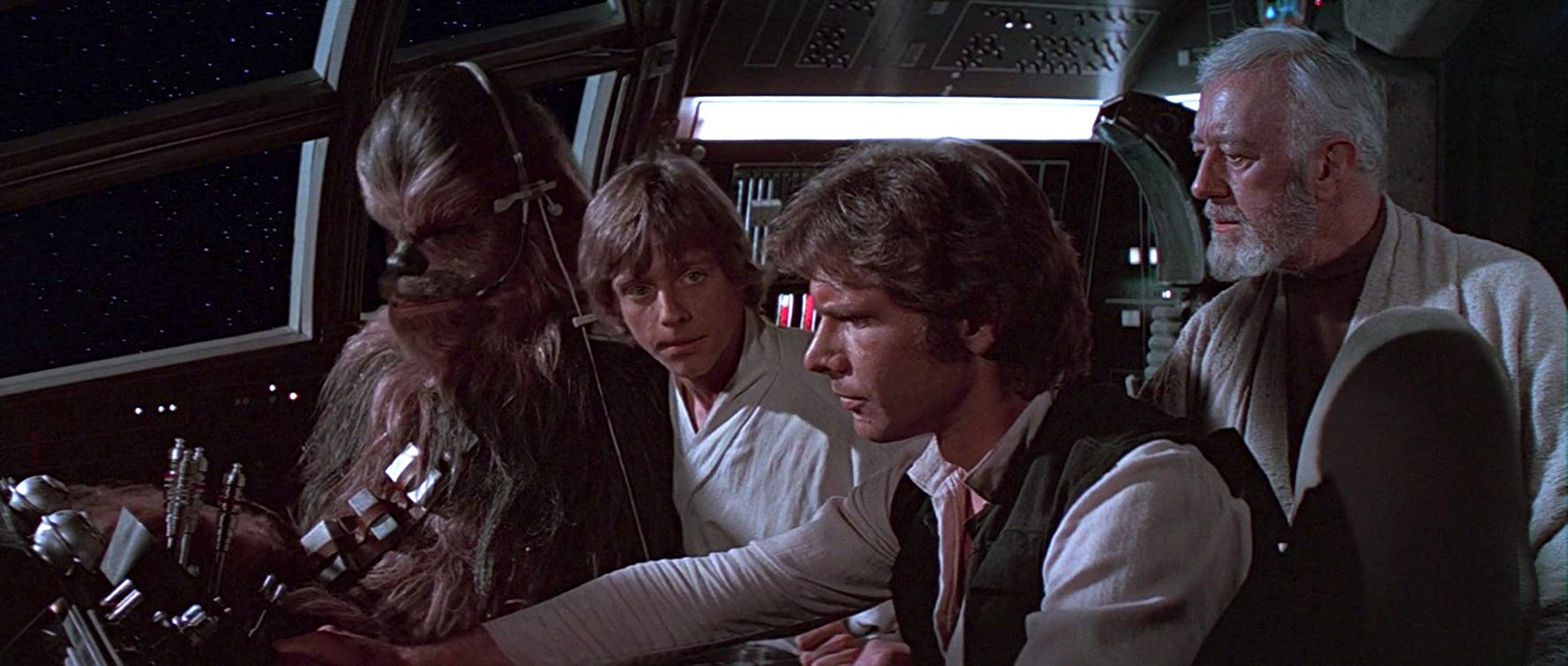 Alec Guinness, Harrison Ford, Mark Hamill, and Peter Mayhew in Star Wars (1977)