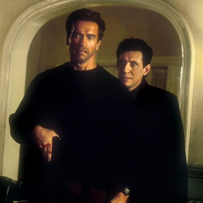 Arnold Schwarzenegger and Gabriel Byrne in End of Days (1999)