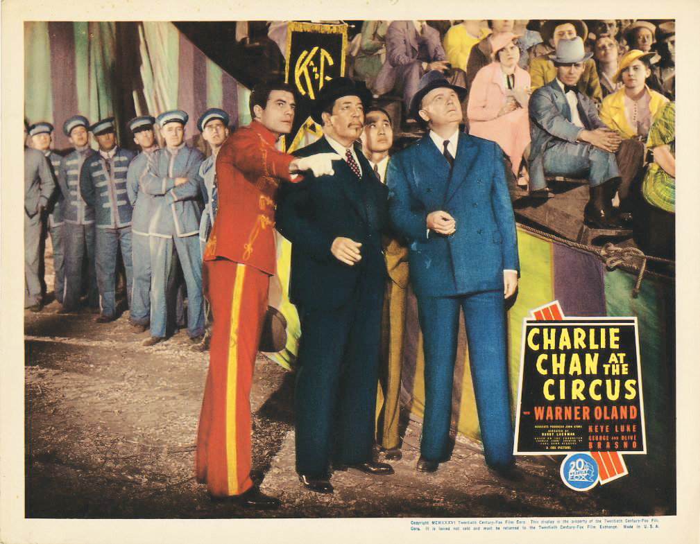 Francis Ford, Keye Luke, John McGuire, and Warner Oland in Charlie Chan at the Circus (1936)