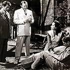 Elisha Cook Jr., Thomas Mitchell, Merle Oberon, and Franchot Tone in Dark Waters (1944)