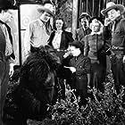 John Wayne, Ray Corrigan, Billy Curtis, Carole Landis, Collette Lyons, David Sharpe, and Max Terhune in Three Texas Steers (1939)