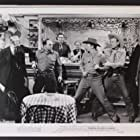 Rex Allen, Harry Cheshire, John Doucette, Paul Harvey, Harry Lauter, and Ian MacDonald in Thunder in God's Country (1951)