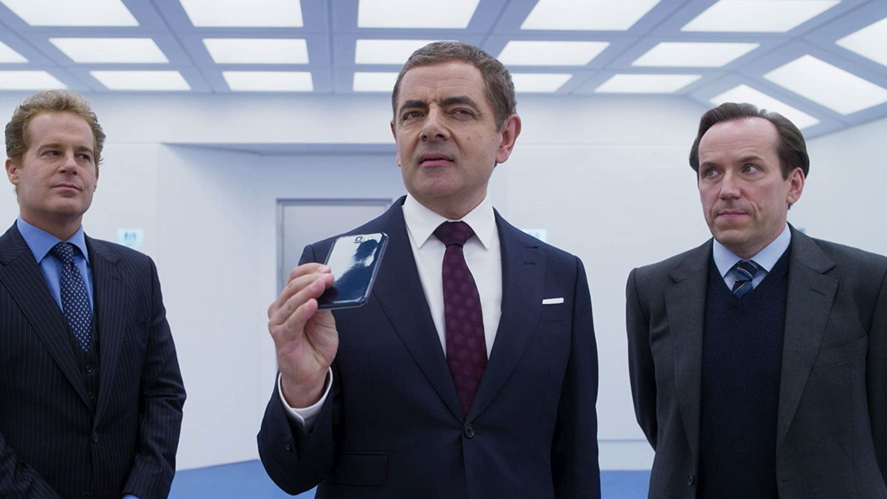 Rowan Atkinson, Adam James, and Ben Miller in Johnny English Strikes Again (2018)
