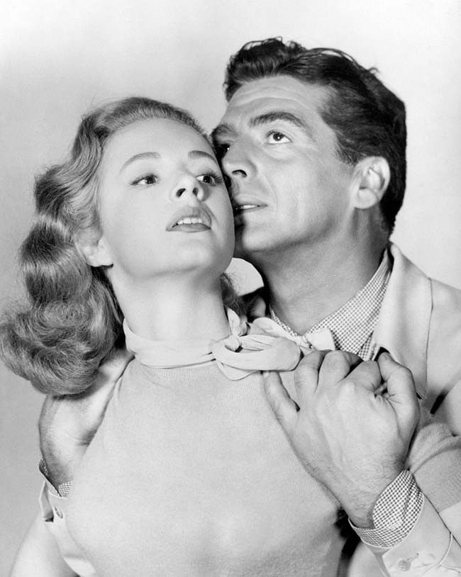 Piper Laurie and Victor Mature in Dangerous Mission (1954)