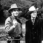 Johnny Mack Brown and Douglass Dumbrille in Flame of the West (1945)