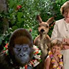 John Cleese, Angus T. Jones, John Kassir, and Christina Pickles in George of the Jungle 2 (2003)