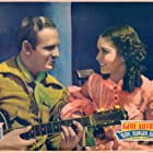 Gene Autry and Kay Hughes in Ride, Ranger, Ride (1936)