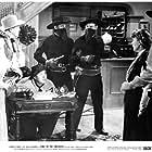 Smiley Burnette, Gail Davis, Don C. Harvey, Mira McKinney, Gene Roth, and Charles Starrett in Trail of the Rustlers (1950)