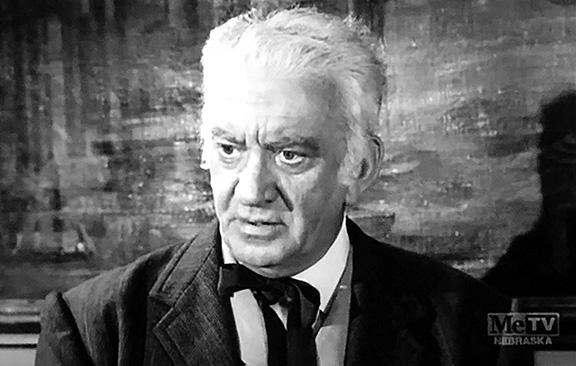 John Litel in Trackdown (1957)