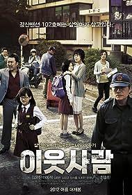 Yunjin Kim, Ho-jin Chun, and Ma Dong-seok in I-ut saram (2012)