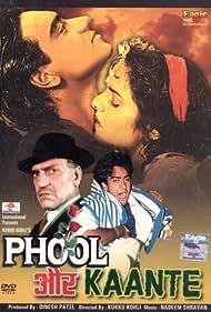 Ajay Devgn, Madhoo, and Amrish Puri in Phool Aur Kaante (1991)