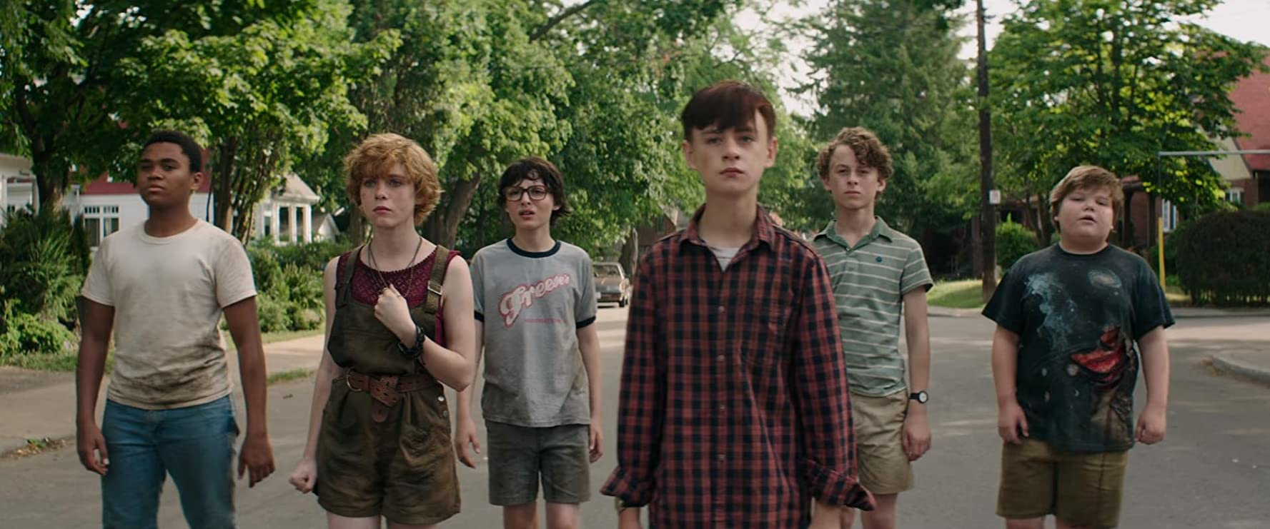 Wyatt Oleff, Jeremy Ray Taylor, Jaeden Martell, Finn Wolfhard, Sophia Lillis, and Chosen Jacobs in It (2017)