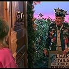 Diane Franklin and Bert Remsen in TerrorVision (1986)