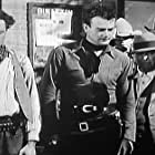 John Wayne, Tommy Coats, Earl Dwire, and Eddie Parker in The Lucky Texan (1934)