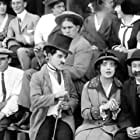 Charles Chaplin and Mabel Normand in Mabel at the Wheel (1914)