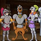 Jason Isaacs, Grey Griffin, Frank Welker, and Kate Micucci in Scooby-Doo! The Sword and the Scoob (2021)