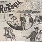 Lucille Lund, Reb Russell, and Rebel in Fighting Through (1934)
