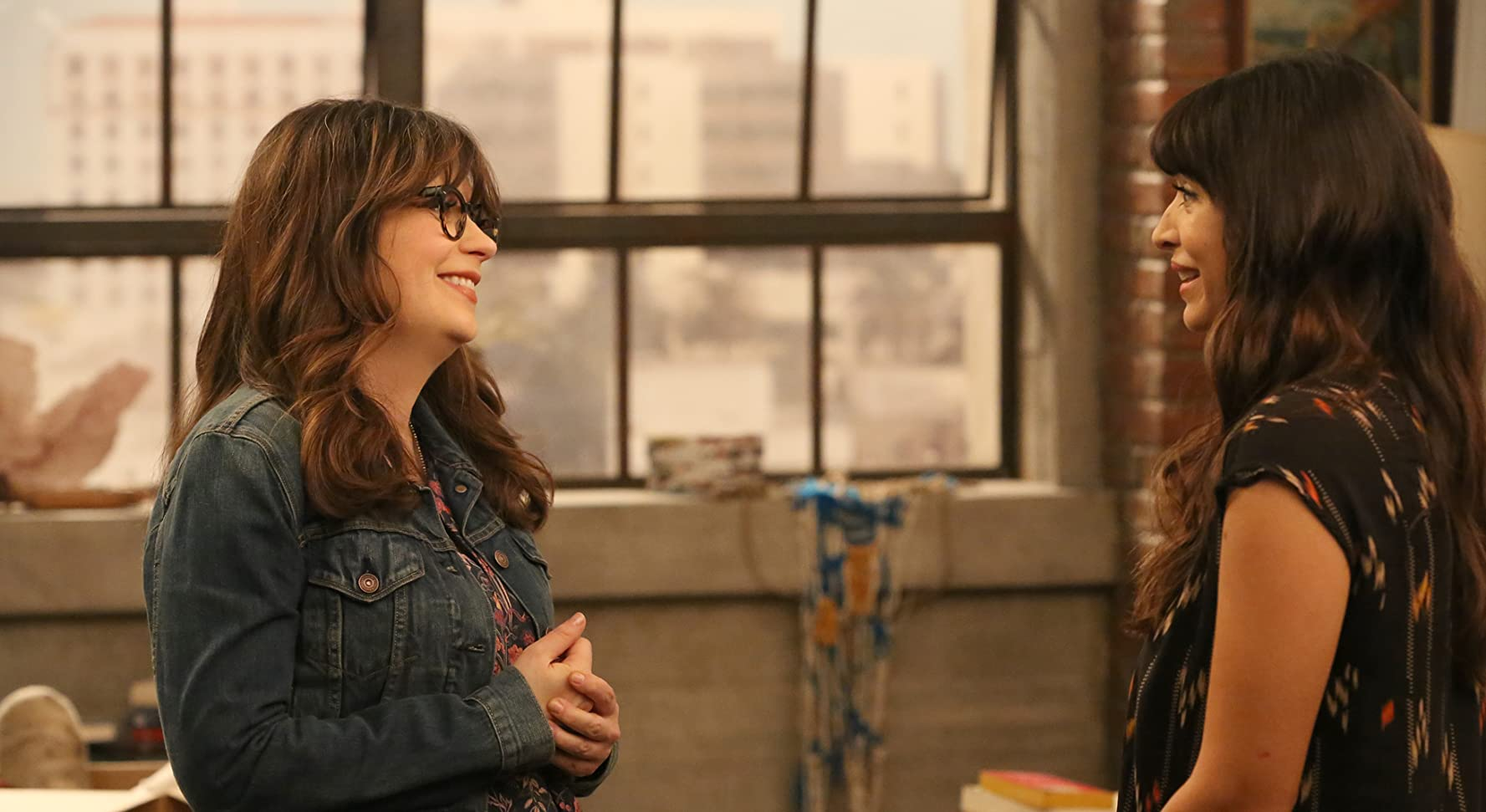 Zooey Deschanel and Hannah Simone in New Girl (2011)