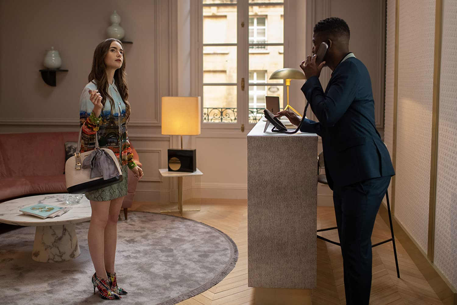 Lily Collins and Samuel Arnold in Emily in Paris (2020)