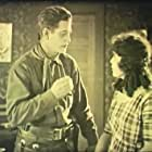 Art Acord and Marcella Pershing in The Show Down (1921)