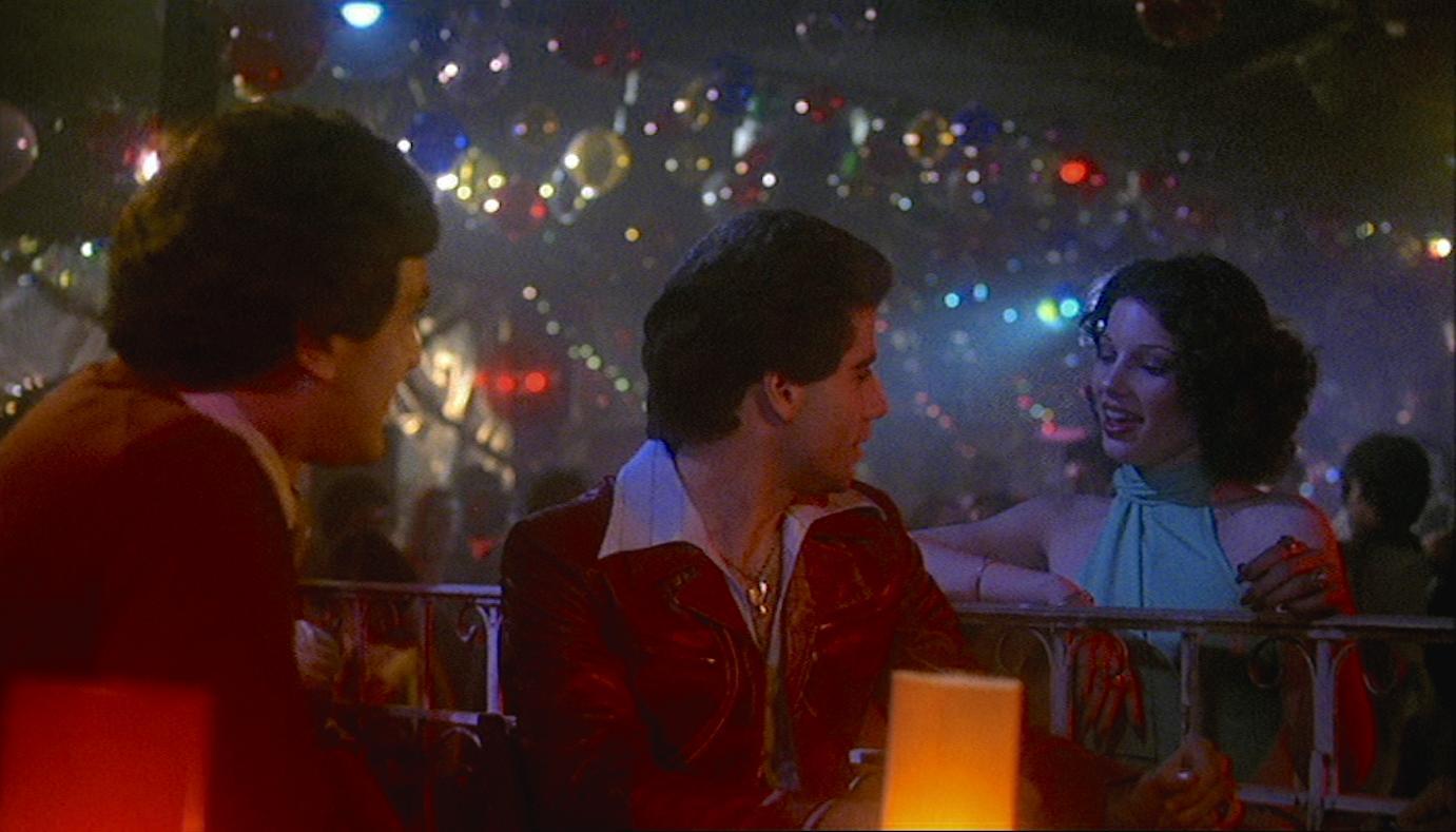 John Travolta, Fran Drescher, and Martin Shakar in Saturday Night Fever (1977)