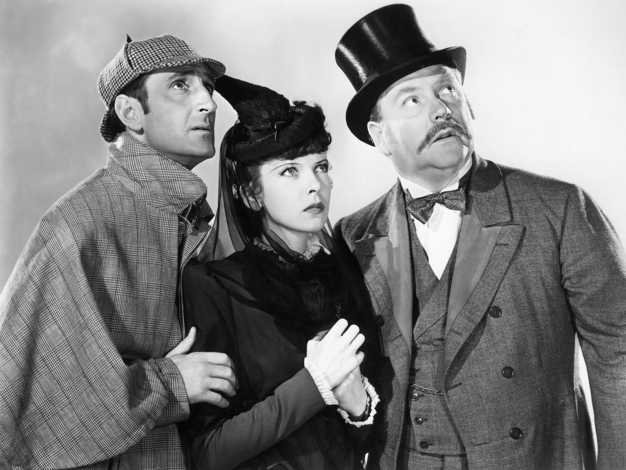 Basil Rathbone, Nigel Bruce, and Ida Lupino in The Adventures of Sherlock Holmes (1939)