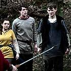 Mia McKenna-Bruce, Gwydion Rhys, Tom Leach, and Richard Mason in The Rebels (2019)