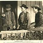 Tim Holt, Lee 'Lasses' White, and Ray Whitley in Thundering Hoofs (1942)