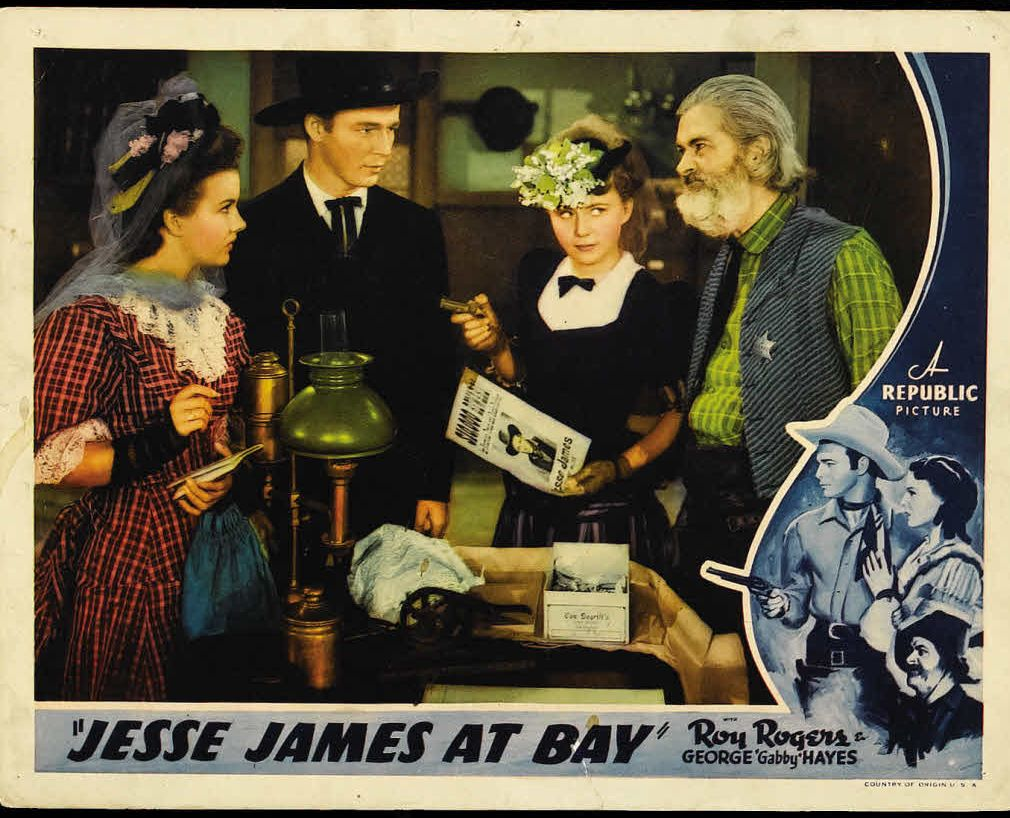 Roy Rogers, George 'Gabby' Hayes, Sally Payne, and Gale Storm in Jesse James at Bay (1941)