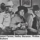 Smiley Burnette, Sunset Carson, and Weldon Heyburn in Code of the Prairie (1944)