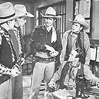 John Bagni, Sammy Baugh, Howard Hughes, Kermit Maynard, and William Kellogg in King of the Texas Rangers (1941)