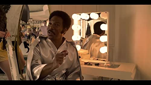 Eddie Murphy portrays real-life legend Rudy Ray Moore, a comedy and rap pioneer who proved naysayers wrong when his hilarious, obscene, kung-fu fighting alter ego, Dolemite, became a 1970s Blaxploitation phenomenon.