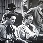 Kermit Maynard, Frank Mitchell, Carl Sepulveda, and Harry Woods in West of Carson City (1940)