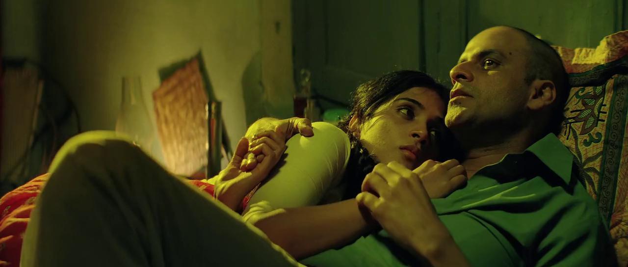 Manoj Bajpayee and Richa Chadha in Gangs of Wasseypur (2012)