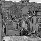 To koritsi tis geitonias (1954)