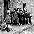 Henry Bergman and Edna Purviance in Easy Street (1917)